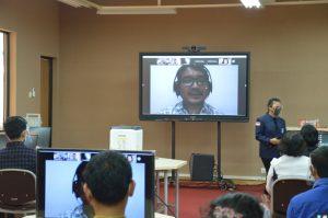 Foto Pemberian kata sambutan oleh Christoper Janwar Saputra Sinaga, S.T., M.A.B selaku Kaprodi FTI secara virtual